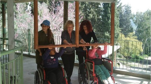 Yael Bar with Nina Paul and a group of children with disabilities. Photo courtesy LOTEM - Making Nature Accessible