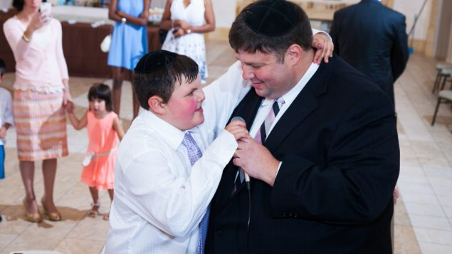 Avi and his uncle, rejoicing at Avi's Bar Mitzvah. Photo courtesy Michelle Steinhart