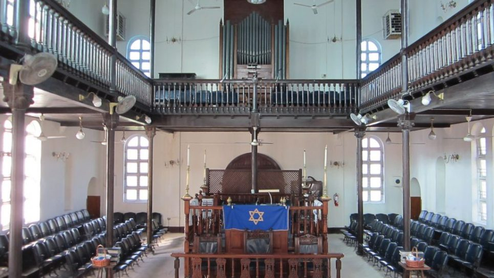 Shaare Shalom, with its sand-covered floor and pipe organ. Elie Klein