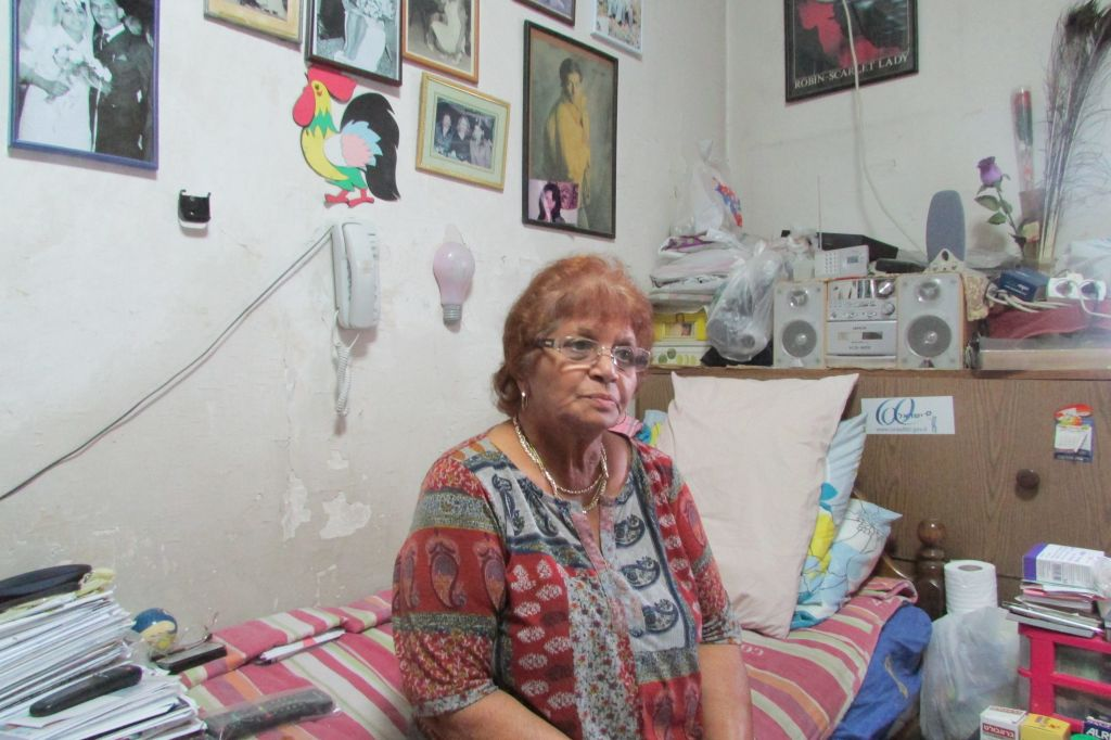 Sophie Menashe in her home near the Tel Aviv New Central Bus Station. (photo credit: Debra Kamin)