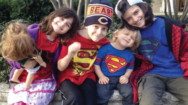 """The Sommer children, three wearing """"Superman Sam"""" T-shirts. Sammy is second from left. Photo courtesy Rabbi Phyllis Sommer"""