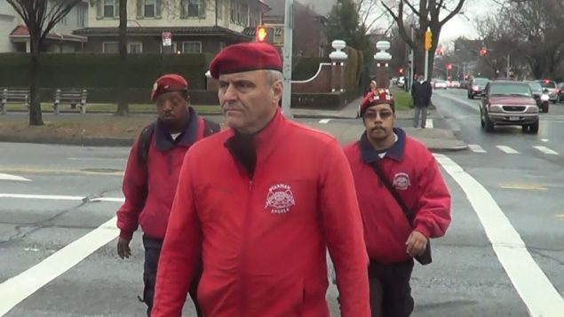 Curtis Sliwa with fellow Guardian Angels Shaggy Wilfred, left, and  Manuel Colon.  Adam Dickter