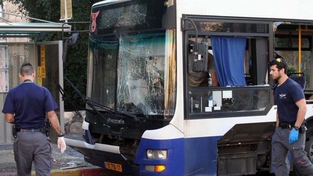 Police and rescue personnel at the scene of an explosion evacuated passenger bus in Bat Yam. Gideon Markowitz/Flash 90
