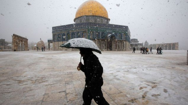On Jerusalem's Temple Mount, a Palestinian man walks in front of the Dome of the Rock mosque. Getty Imges