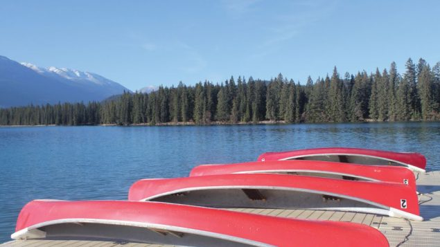 Canoes on the shore of Beauvert Lake at the Fairmont Jasper Park Lodge. George Medovoy