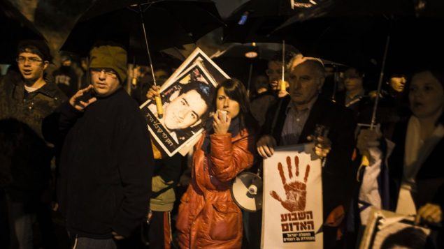 "Israelis protest release of Palestinian prisoners. The sign with red handprint reads ""week of blood."" Getty Images"
