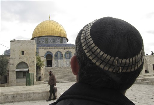 In this Monday, December 9, 2013 photo, a Jewish man looks towards the Dome of the Rock in Jerusalem. (photo credit: AP/Simone Camilli)