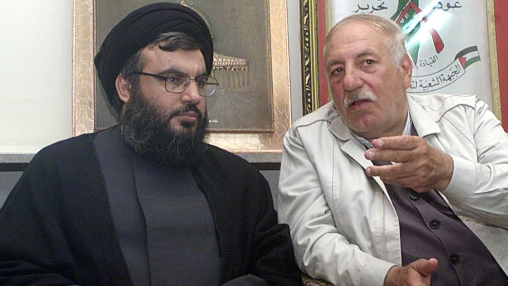 PFLP-GC chief Ahmed Jibril (right) pictured with Hezbollah leader Hassan Nasrallah in Beirut in May 2002. (photo credit: AP Photo/Bassem Tellawi)
