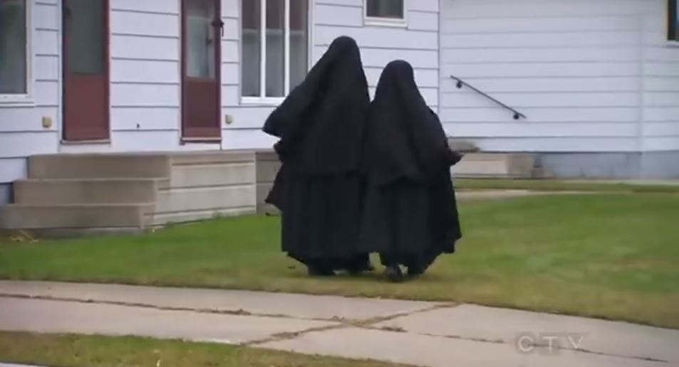 Lev Tahor girls walking in Chatham, Ontario, earlier this month (photo credit: YouTube screenshot)