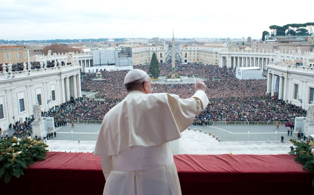 Pope Francis delivers his 'Urbi et Orbi' (to the City and to the World) message from the central balcony of St. Peter's Basilica at the Vatican, Wednesday, December 25, 2013 (photo credit: AP/Gregorio Borgia)