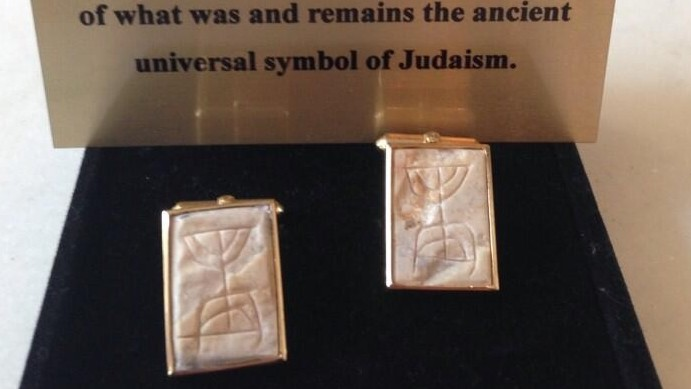 The cufflinks Ambassador Ron Dermer gave President Barack Obama, showing an image of the ancient menorah etching found in Jerusalem's City of David (photo credit: Twitter/ Amb. Ron Dermer)