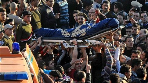 Egyptians carry the coffin of a victim killed in an explosion at a pol