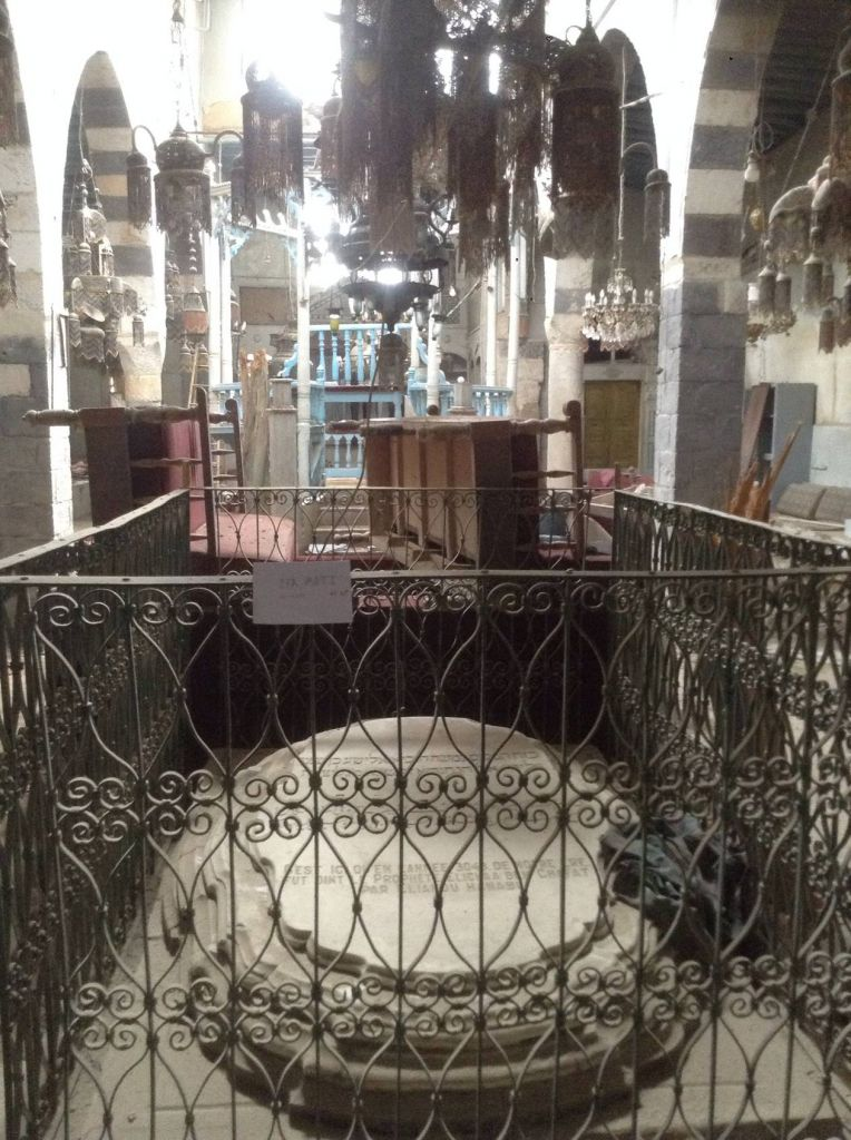 A photograph of the Jobar Synagogue in  Damascus, including a handwritten sign indicating the picture is recent (photo credit: courtesy)