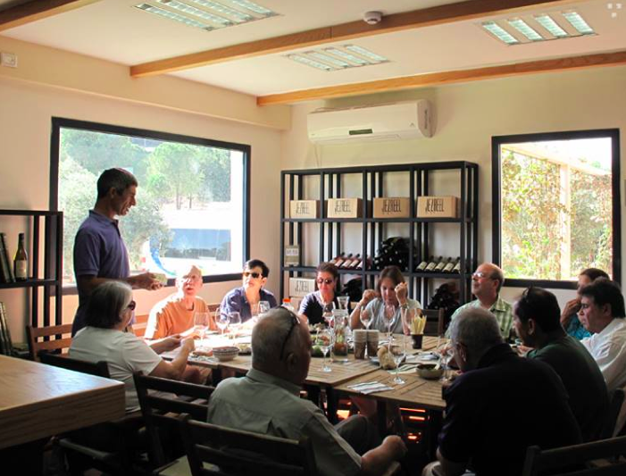 Serial entrepreneur Jacob Ner-David speaking to a group of visitors at the Jezreel Winery (Courtesy Jezreel Winery)