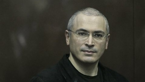 Mikhail Khodorkovsky looks from behind a glass enclosure in a court room in Moscow, Russia, Dec. 30, 2010 (photo credit: AP /Alexander Zemlianichenko Jr)