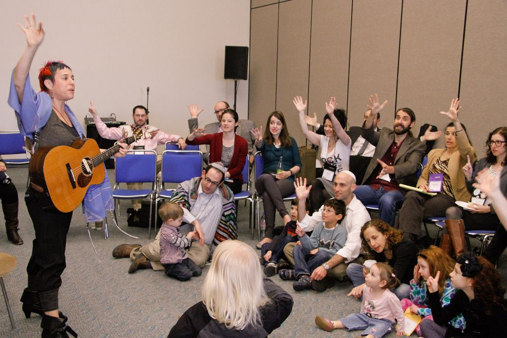 A group meeting for a 'P'sukei D'zimra' morning service before the main Shabbat worship service at the Reform biennial in San Diego, Dec. 14, 2013. (photo credit: URJ via JTA)