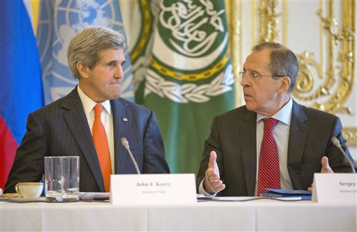 U.S. Secretary of State John Kerry, left, listens to Russia's Foreign Minister Sergey Lavrov before the start of their joint meeting with U.N.-Arab League envoy for Syria Lakhdar Brahimi at the U.S. ambassador's residence in Paris, France, Monday, January 13, 2014. (photo credit: AP/Pablo Martinez Monsivais, Pool)