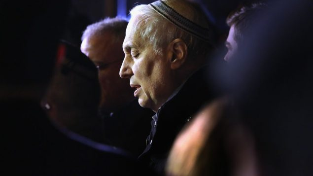 Rabbi Avi Weiss prays at a vigil for victims of a train derailment in December, 2013. Getty Images