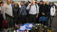 Mourner pays final respects at the grave of Ariel Sharon in Havat Hashikmim on Jan. 13. Getty Images