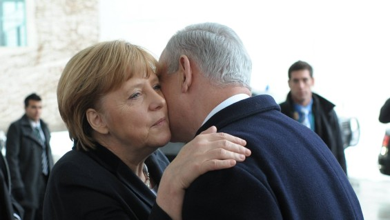 German Chancellor Angela Merkel and Israeli Prime Minister Benjamin Netanyahu embrace after attending a joint press conference in Berlin, Germany, on December 6, 2012. (photo credit: Amos Ben Gershom/GPO/Flash90)