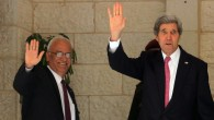 US Secretary of State John Kerry (R) and Palestinian chief negotiator Saeb Erekat wave before a meeting with Palestinian Authority President Mahmoud Abbas at the presidential compound in the West Bank city of Ramallah January 4, 2014. (photo credit: Issam Rimawi/Flash90)