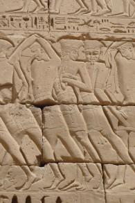 Relief depicting Sea Peoples taken captive by Ramesses III at the temple of Medinet Habu. (photo credit: CC BY-SA Rémih, Wikimedia Commons)