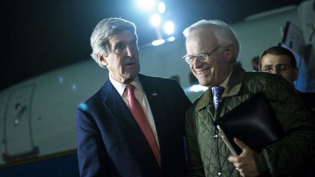 US Secretary of State John Kerry, left, walks with US Special Envoy for Israeli-Palestinian Negotiations Martin Indyk, right, at Ben Gurion International Airport, Tel Aviv, Israel, on January 5, 2014. (photo credit: AP/Brendan Smialowski/Pool)