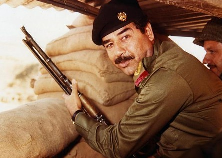 Saddam Hussein during Iran-Iraq war in the 1980s. (Public domain, Wikimedia Commons)