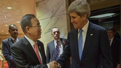 US Secretary of State John Kerry, right, is greeted by UN Secretary General Ban Ki-Moon, left, before the start of their meeting at Bayan Palace in Kuwait City, Kuwait, Wednesday, Jan. 15, 2014. (photo credit: AP/Pablo Martinez Monsivais, Pool)
