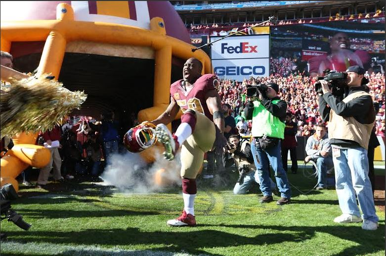 An enthusiastic London Fletcher being introduced as a starter for the Washington Redskins. He holds the NFL record for consecutive starts by a linebacker with 216 while playing for three teams. (photo credit: Courtesy Washington Redskins)