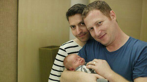Eran Pnini Koren and Avi Koren, a gay Israeli couple, with their child conceived through the surrogacy procedure in Thailand. (photo credit: Facebook)