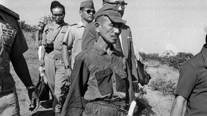 Hiroo Onoda, wearing his 30-year-old imperial army uniform, cap and sword, walks down a slope as he heads for a helicopter landing site on Lubang Island for a flight to Manila when he comes out of hiding in the jungle on the island, Philippines. (photo credit: AP Photo)