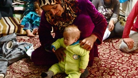 An emaciated child and her mother in the Kawargosk refugee camp (photo credit: courtesy/Kelsey Cannon)