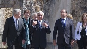 German President Joachim Gauck, Robert Hebras, one of two survivors still alive and French President Francois Hollande, walk through the ghost city of Oradour-sur-Glane, France, the site of a massacre during WWII (AP Photo/Michel Euler, Pool,File)