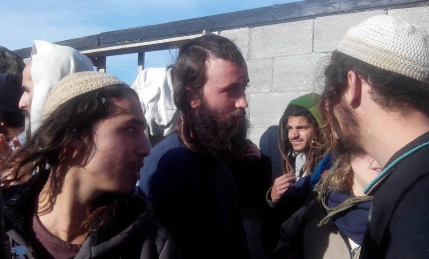 Settlers from the Esh Kodesh outpost, leaving the West Bank village of Qusra (photo credit: Zachariah, Rabbis for Human Rights)