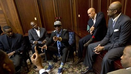 Dennis Rodman, center, speaks with f