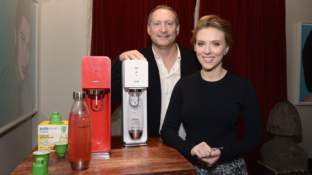 Scarlett Johansson with Sodastream's Daniel Birnbaum (photo credit: Mike Coppola/Getty Images for SodaStream/via JTA)