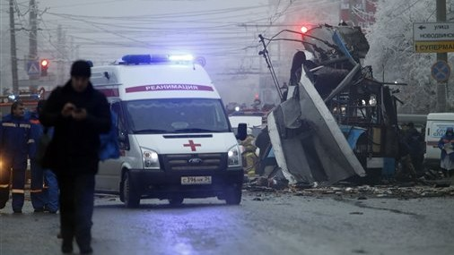 An ambulance leaves the site of an explosion after a bomb blast tore through the trolley. (photo credit: AP Photo/Denis Tyrin, File)