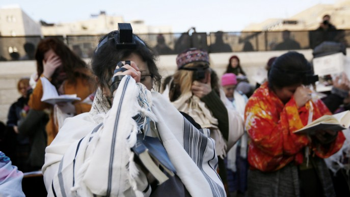 Members of the Women of the Wall organization wear prayer shawls as they pray at the Western Wall, Judaism's holiest site, in Jerusalem, January 02, 2014 (photo credit: Miriam Alster/Flash90)