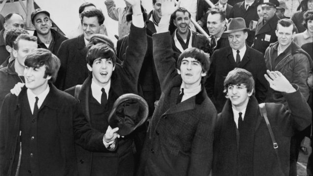 The Beatles arrive at JFK 50 years ago this month. Wikimedia Commons