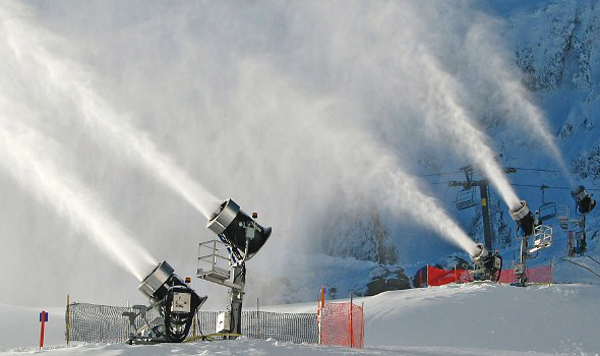 Snowmaking machines like this will guarantee Olympic-quality ski slopes at the Sochi Games. Photo via snowmakers.com