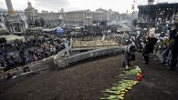 People lay flowers for protesters killed in past weeks' clashes with riot police in Kiev's Independence Square. Getty Images