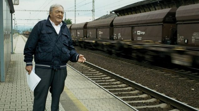 Lanzmann at train station outside of Terezin. Courtesy of Synecdoche/Le Pacte
