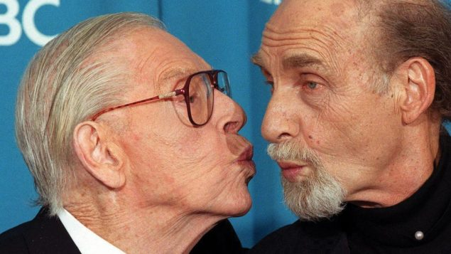 Kissing comic cousins: Milton Berle, left, and Sid Caesar in photo from the 1998 Emmy Awards. Getty Images