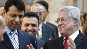 Palestinian Authority President Mahmoud Abbas (right) smiles as he leaves a news conference in Egypt, in February  2007. At left is Mohammad Dahlan, then a close confidant of Abbas. (photo credit: AP/Amr Nabil)