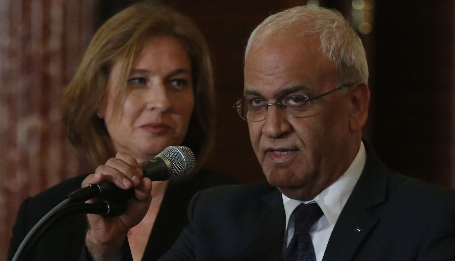Peace negotiators Tzipi Livni and Saeb Erekat at the State Department in Washington, July 30, 2013  (photo credit: AP/Charles Dharapak)