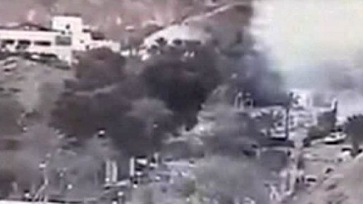 An image made from a video provided by the Israeli Airports Authority shows smoke, white area at upper right,. from the bombing of the bus carrying South Korean sightseers near the tip of the Red Sea's Gulf of Aqaba Sunday Feb. 16, 2014. (photo credit: AP Photo/Israeli Airports Authority)