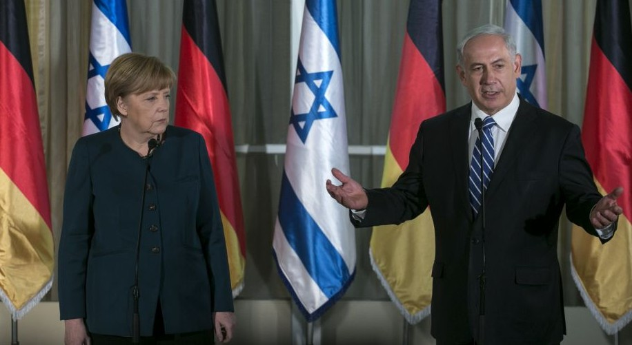 Germany's Chancellor Angela Merkel and Prime Minister Benjamin Netanyahu give a joint press conference at the prime minister's residence in Jerusalem on February 24, 2014. (Photo credit: Olivier Fitoussi/POOL/Flash90)