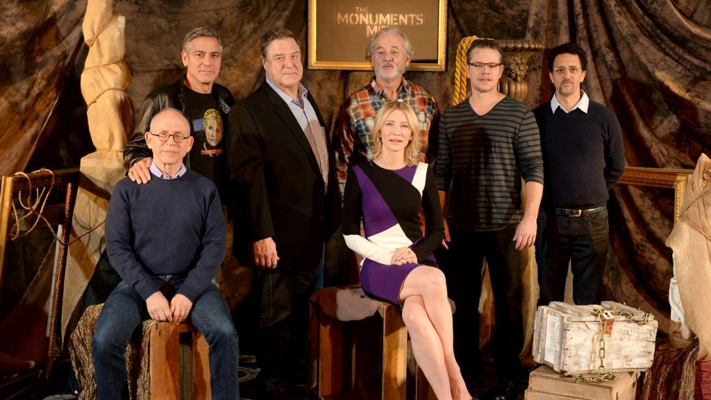 "From left: actor Bob Balaban, director, screenwriter and actor, George Clooney, actor John Goodman, actor Bill Murray, actress Cate Blanchett, actor Matt Damon and screenwriter Grant Heslov pose during a photocall for ""The Monuments Men,"" January 16, 2014 (photo credit: AP/Jordan Strauss/Invision)"