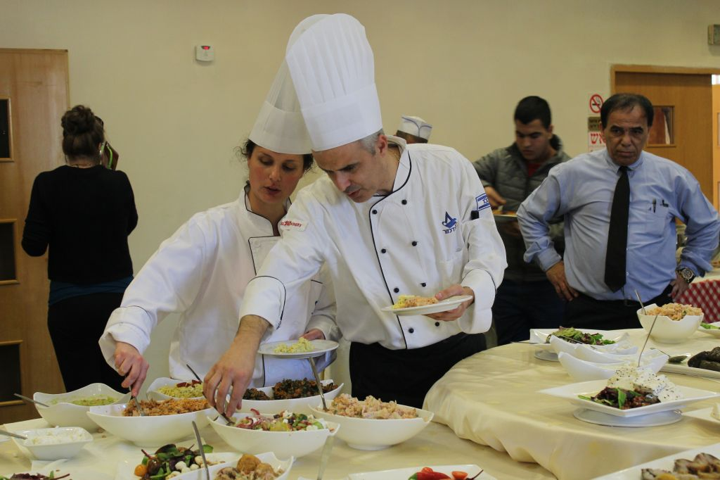 Chefs and guests helped themselves to a meal prepared by students at the Tadmor School for Hotel Management in Herzliya after a bread-baking competition between Tadmor and French students (photo credit: Rebecca McKinsey/Times of Israel)